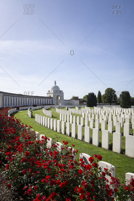 Belgium - September 29, 2018: Memorial wall and roses on Tyne Cot Cemetery, the largest British military cemetery in the world.