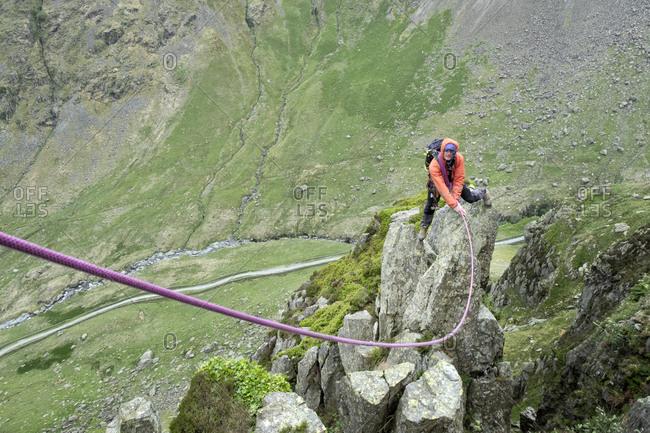 UK- Lake District- Longsleddale valley- Buckbarrow Crag- man climbing on rock