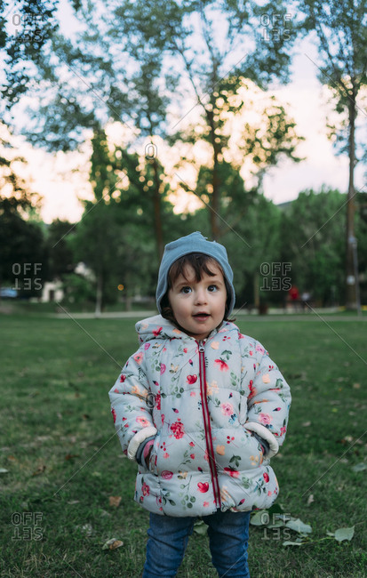 Portrait of fashionable little girl in autumnal park