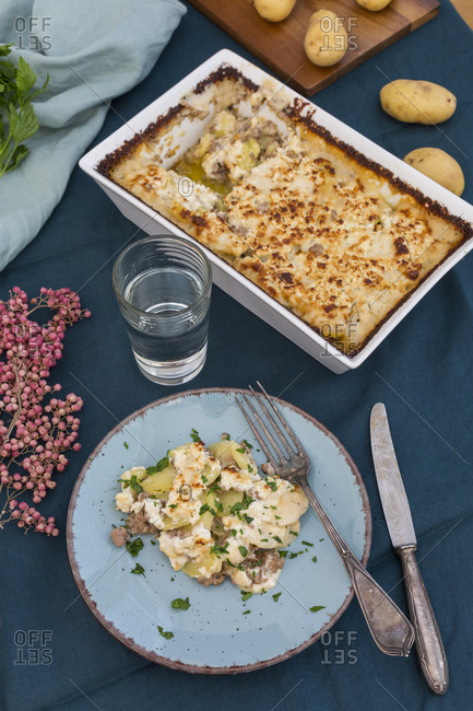 Casserole of potato mincemeat gratin with sheep cheese