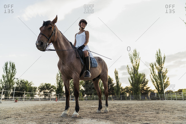 Smiling woman on horse