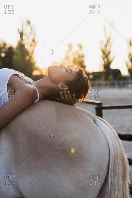 Woman relaxing on horseback - Offset