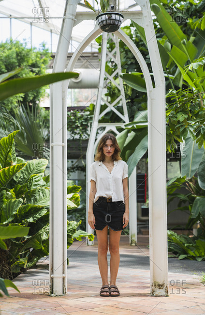 Beautiful woman standing in greenhouse