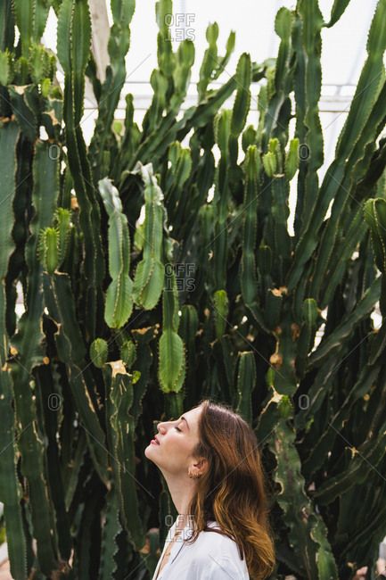 Portrait of a young woman in front of cacti