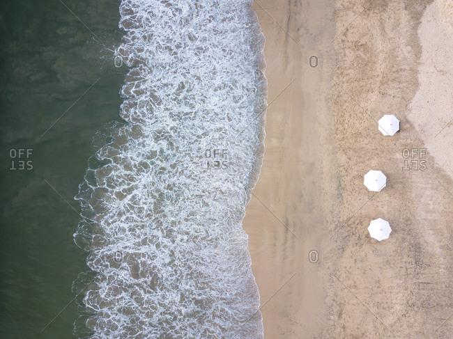 Indonesia- Bali- Aerial view of Jimbaran beach- white sunshades from above