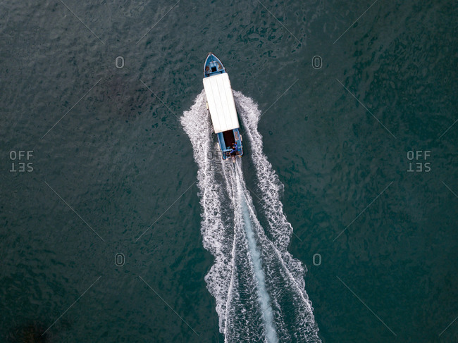Indonesia- Bali- Aerial view of excursion boat