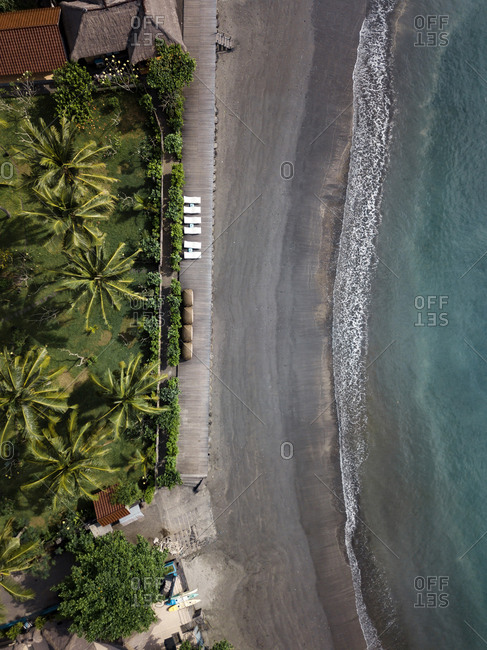 Indonesia- Bali- Aerial view of beach with empty sun loungers