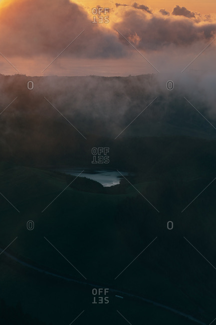 Lake with thick fog above