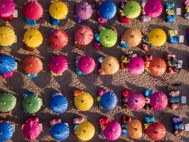 October 9: aerial view of colorful parasols in Seminyak beach, Bali