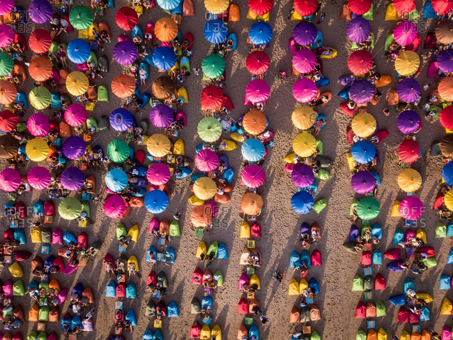 October 9: aerial view of colorful parasols in Seminyak beach, Bali