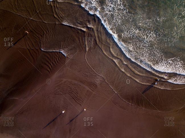 Aerial view of people in Seminyak's beach in Bali, Indonesia