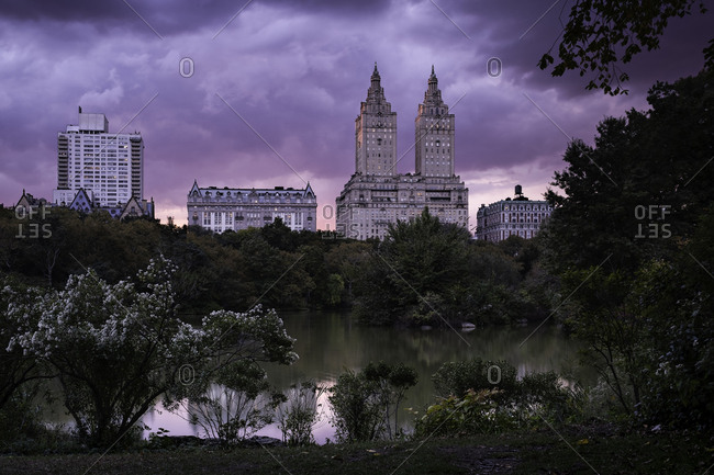 Pink sky sunset over lake in Central Park in New York City, United States