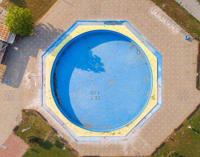 Abstract aerial view of empty pool in abandoned pool in water park.