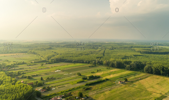 Aerial view of meadows and forest in the hinterland of Osijek, Croatia.