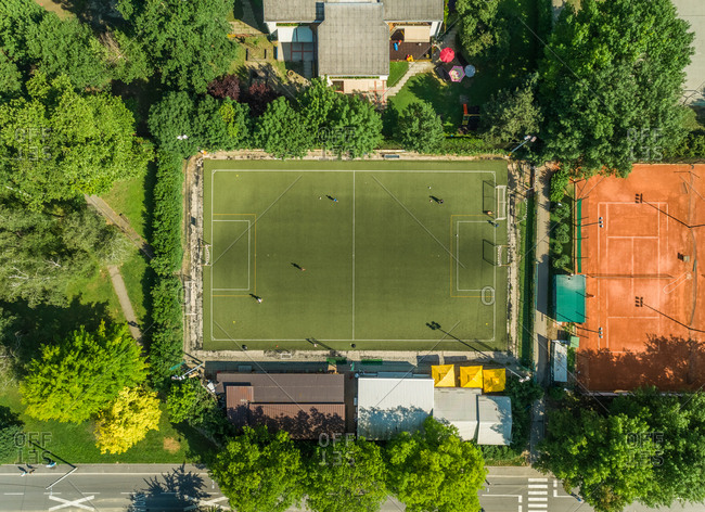 Aerial view of a football training pitch in suburban setting.