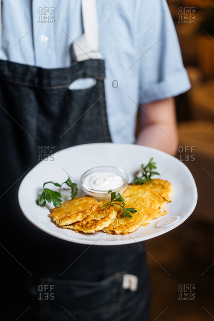 Chef serving chicken fritters