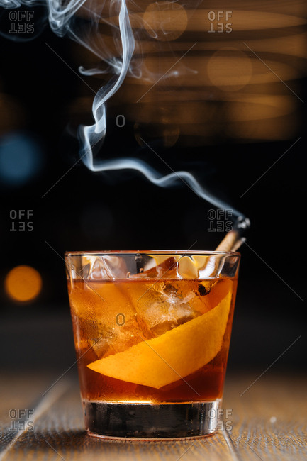 Cocktail served with smoking cinnamon stick