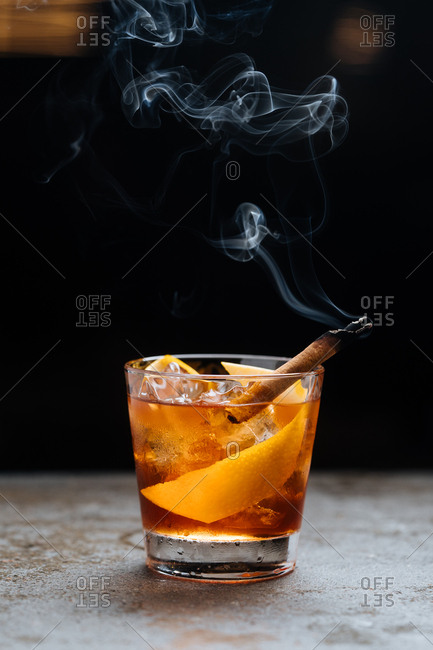 Cocktail with smoking cinnamon stick