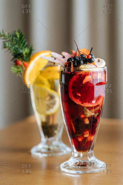 Two fruity cocktails with berries and lemons
