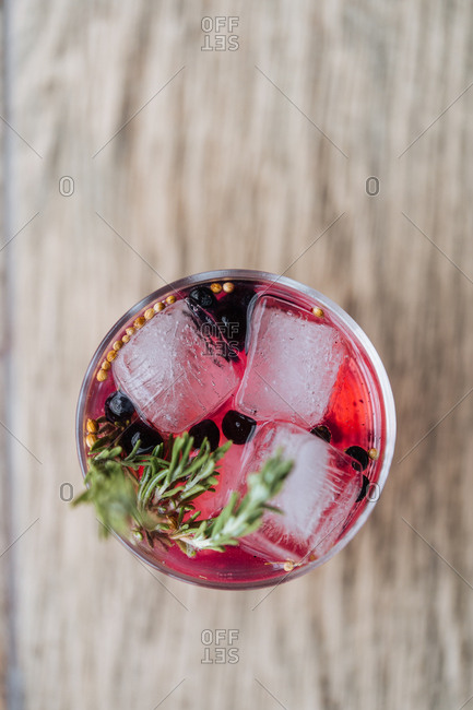 Overhead view of fruity cocktail with rosemary