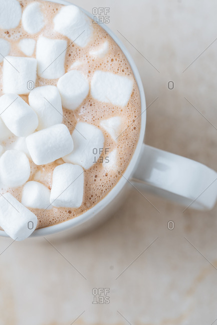 Overhead view of hot cocoa topped with marshmallows