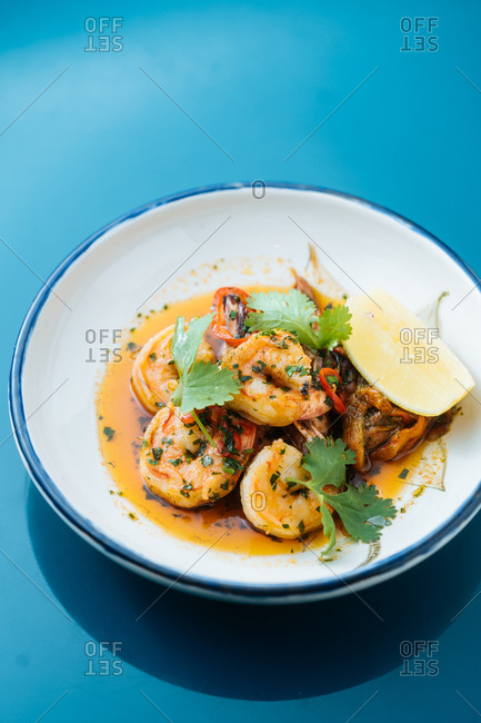 Shrimp dish with sauce and lemon