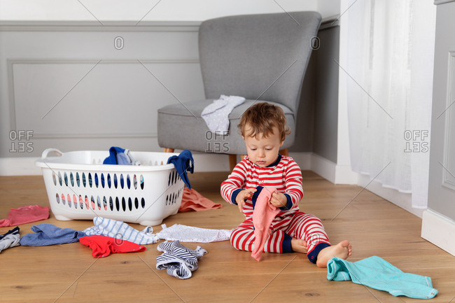 Baby playing with the laundry