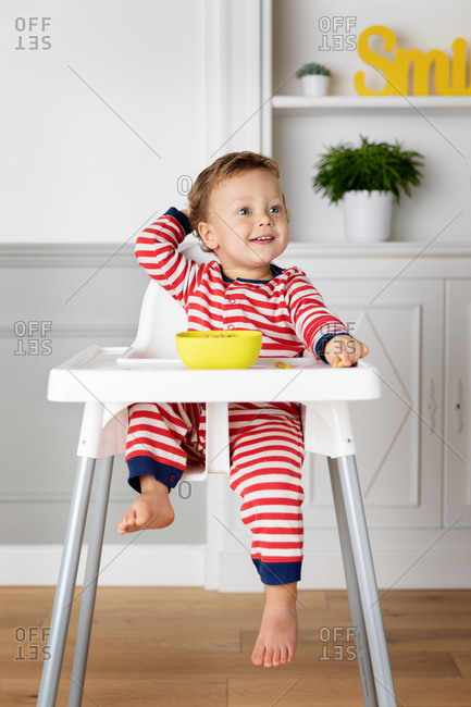 Smiling baby sitting in high chair