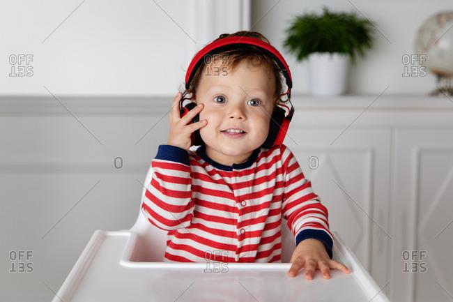 Smiling toddler boy wearing headphones