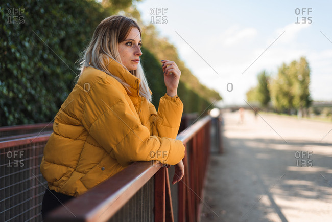 Young woman posing on a bridge