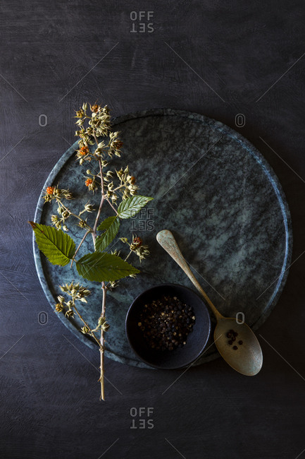 Overhead view of circular marble cutting board and wild berry