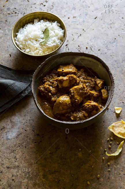 Bowls of chicken tikka masala and rice