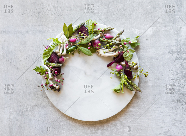 Overhead view of circular cutting board with beautiful ingredients