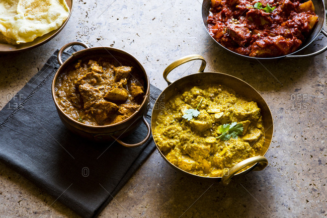 Three bowls of Indian curry dishes