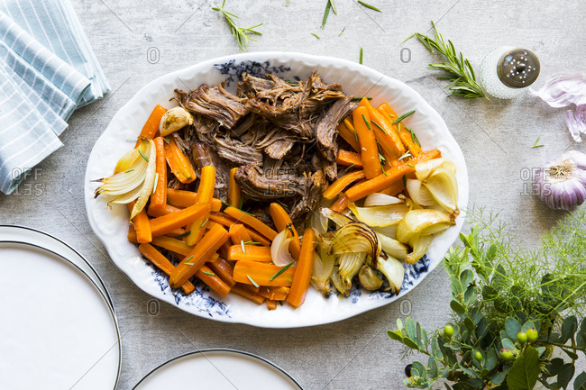 Serving plate of pot roast and vegetables