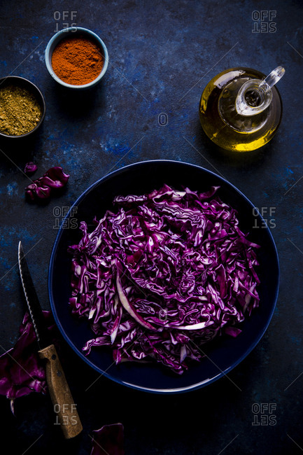 Bowl of chopped red cabbage with seasonings