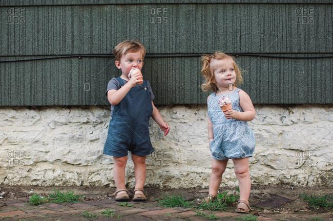 Toddler siblings eating ice cream