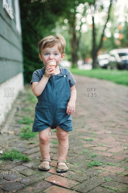 Toddler boy eating an ice cream