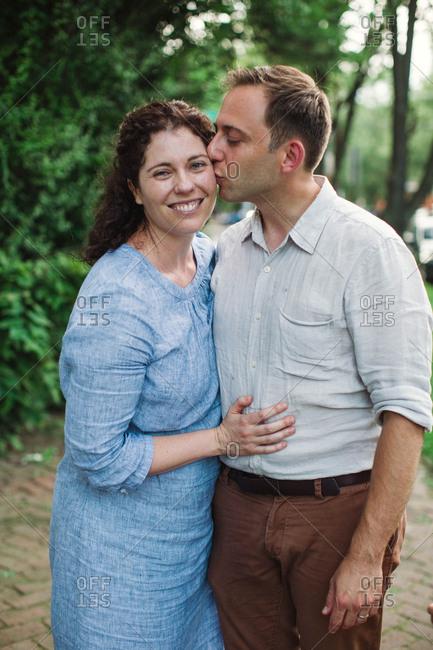 Husband kissing wife's cheek