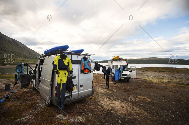 Van with kayaks and clothes on the coast of the Lofoton Islands, Norway