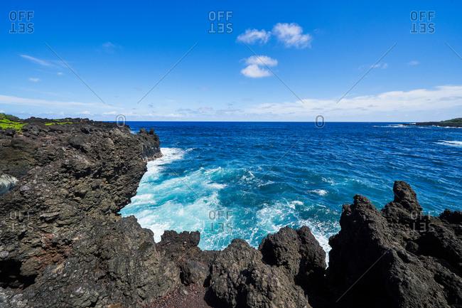 Blue waters on the rocky coast of Hana, Maui, Hawaii