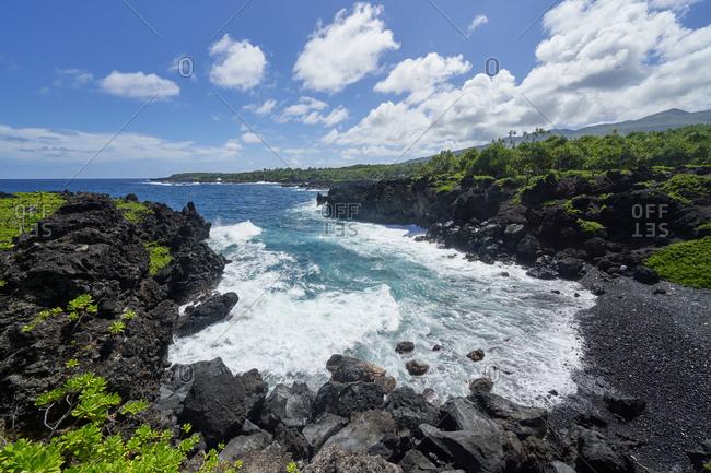 Waves crashing onto the rocky coast of Hana, Maui, Hawaii