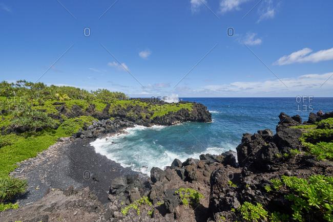 Waves rolling into the rocky coast of Hana, Maui, Hawaii