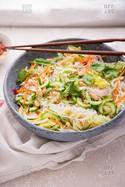 Vegetarian salad with rice noodles, fresh vegetables