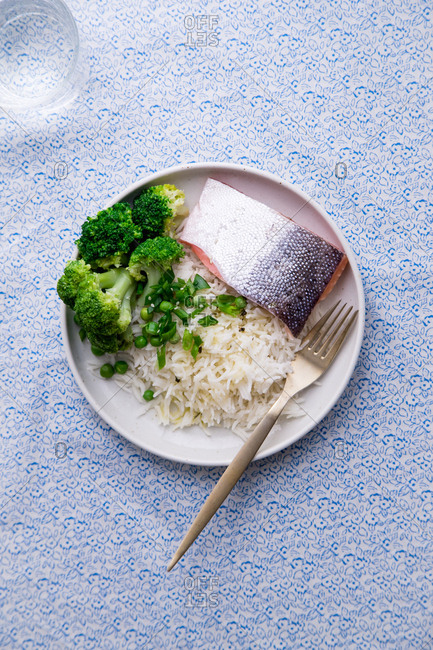 Cooked salmon with basmati rice, broccoli and beans. Healhy nutrition concept