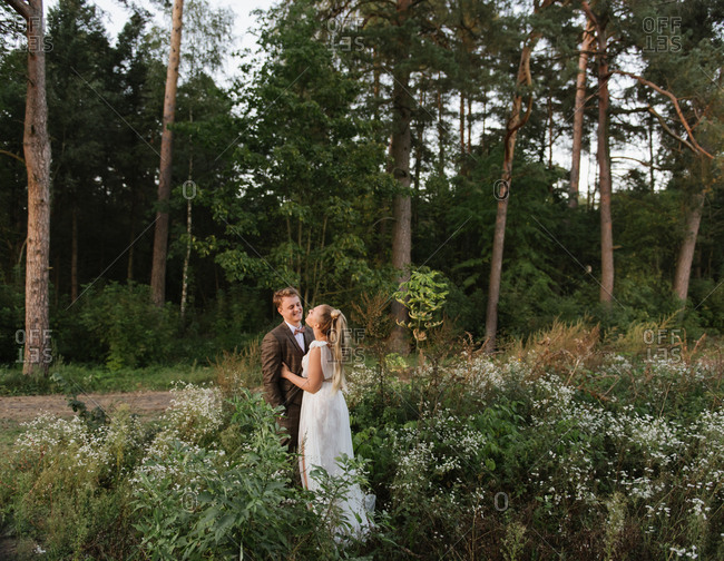 Wedding couple feeling positive in the forest