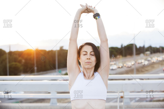 Woman stretching on bridge
