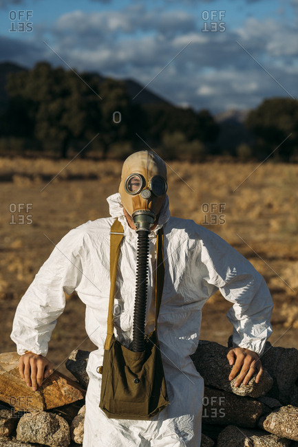 Man with tear gas mask and white scientist costume