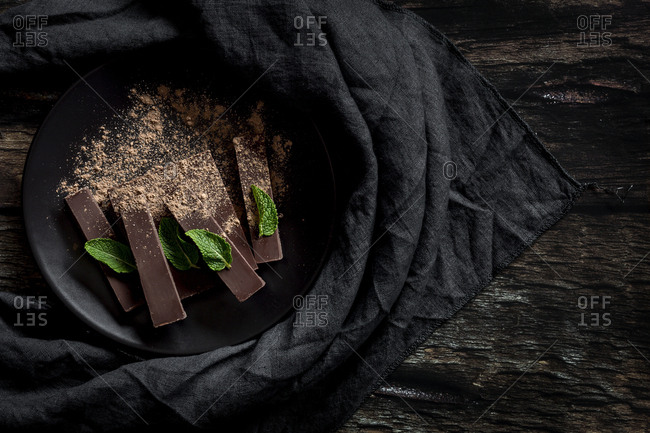 Chocolate with mint in a dark background