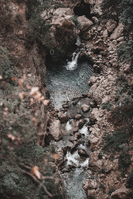 From above small cascade falling to tiny lake in gorge in Morocco